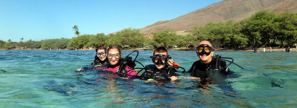 family snorkeling on the west side of maui
